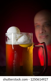Glass with beer and balls for playing ping pong
