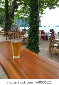 A glass of beer with beach front view in Ao Nang, Krabi Thailand.