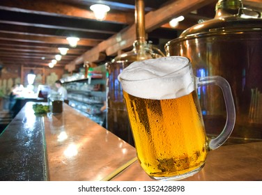 Glass of beer in the brewery.