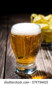 glass of beer and chips, vertical
