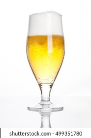 Glass of beer cider with foam golden color on white background