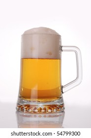 Glass of beer close-up with froth