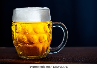 Glass of beer with drops of water