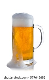 glass of beer with foam that runs on a white background
