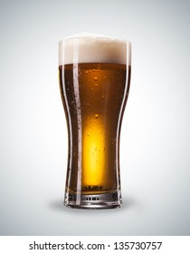 Glass of beer with froth close up with clipping path