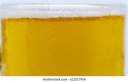 Glass of beer with ice at bottom background