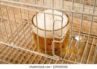 Glass of beer inside a cage, a concept on alcohol addiction and abuse