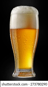 glass of beer isolated on black background
