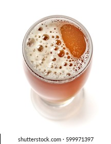glass of beer isolated on white background, top view