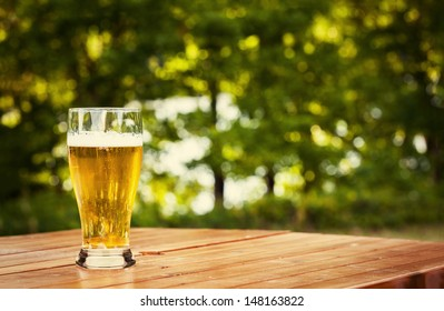 Glass of beer in nature