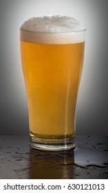 glass of beer on background