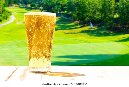 Glass of beer on the background blur of golf.