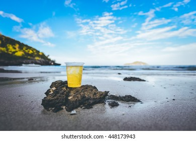 Glass of beer on the beach