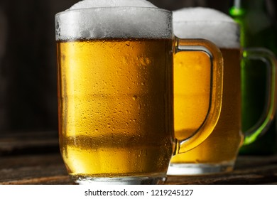 Glass of beer on a dark background