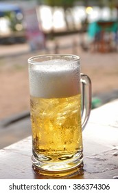 Glass of beer on the restaurant table