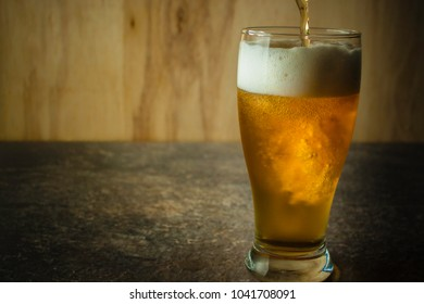 glass of beer on a stone table