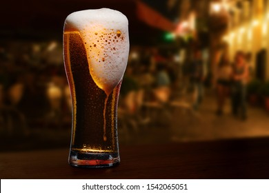 glass of beer on a street bar table