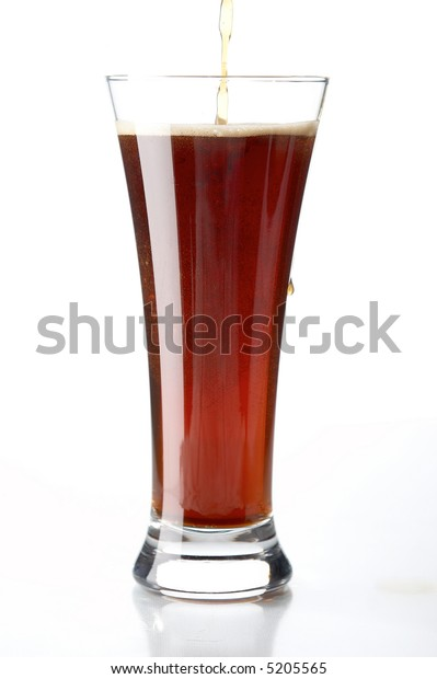 glass with beer on the white background