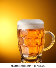 glass of beer on a yellow background