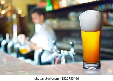 Glass of beer in the pub