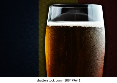 A glass of beer. Romania flag in the background. One of the countries where beer consumption is highest in the world.