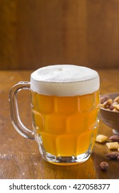 Glass of Beer with Snacks on Counter
