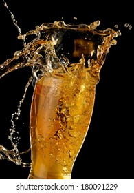 Glass with beer up and splash