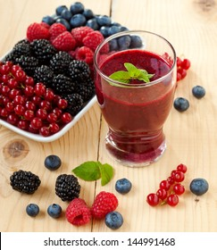 A glass of berry smoothie with fresh fruits, shallow depth of field