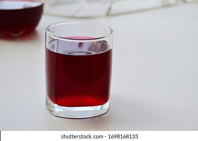 glass glass with blackcurrant juice on the window horizontal orientation