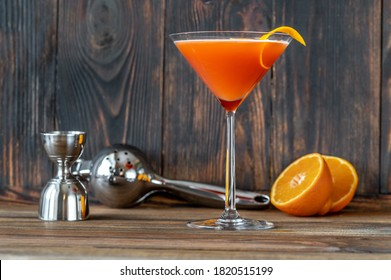 Glass of Blood And Sand Cocktail in martini glass garnished with orange peel