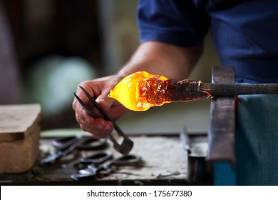 Glass blower forming beautiful piece of glass, Murano, Venice, Italy