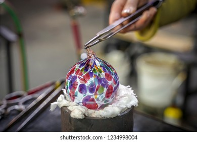 A Glass Blower Making a Beautiful Piece of Art