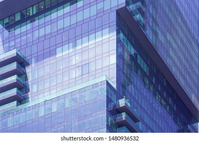 Glass blue square Windows of facade modern city business building skyscraper. Modern apartment buildings in new neighborhood. Windows of a building, texture. 2 June 2019. Tel Aviv. Israel.