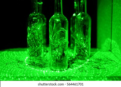 Glass bottle in abstraction with laser lights.