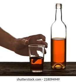 glass and bottle of brandy isolated on the white background