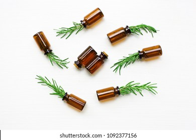 Glass bottle of essential oil  with rosemary.