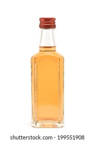 glass bottle filled with liquid brown color on a white background