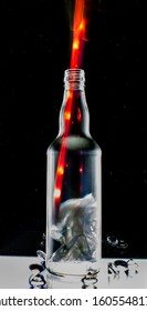 glass bottle in the foreground framed by light painting