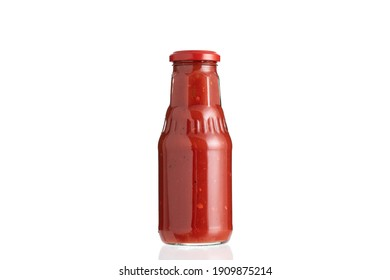 Glass bottle of ketchup isolated on white background.