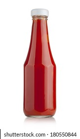 Glass bottle of ketchup on white background with clipping path