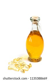 glass bottle of oil with vitamin capsules