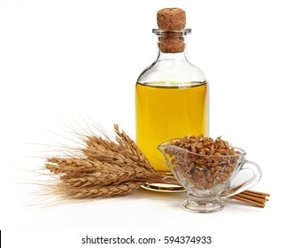 Glass bottle with Olive Oil, Ears of Wheat and Sprouted Wheat on a White Background