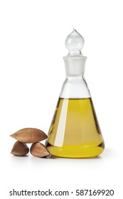 Glass bottle with Pili nut oil and whole pili nuts
