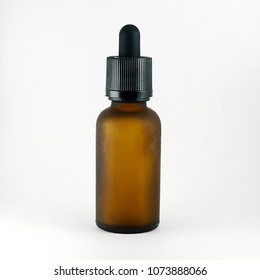 Glass bottle with pipette 30 ml brown matte on a light background