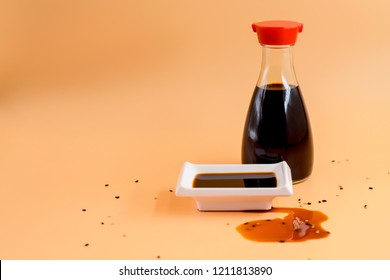glass bottle of soy sauce and bowl of soy sauce