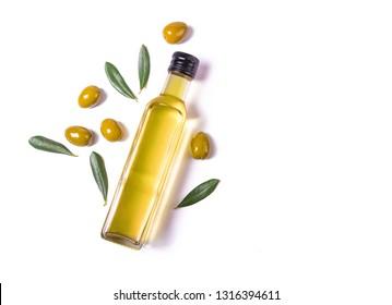 Glass bottle of virgin olive oil and green olives