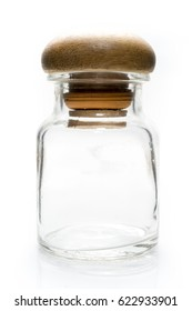 Glass bottle with wooden Lid on White background
