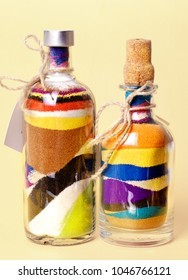 Glass bottles with colored sand. Sand art in a bottle