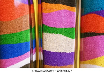 Glass bottles with colored sand. Sand art in a bottle - close up