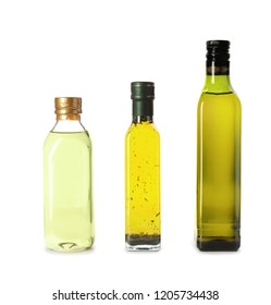 Glass bottles with different oils on white background